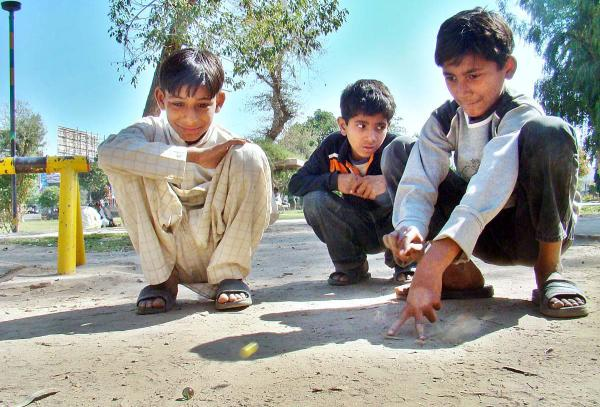 Kids Playing With Guli DandaGuli Danda is a traditional sport for little